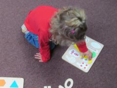 Small child doing puzzles